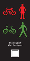 Near side light signals and instructions for pedestrians and cyclists at a Toucan crossing
