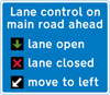 Lane control signals in operation on the road extending from the junction ahead