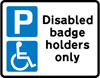 Parking place reserved for disabled badge holders