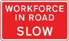 Vehicular traffic should proceed slowly owing to workforce in the road