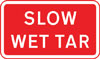 Vehicular traffic should proceed slowly owing to temporary hazard resulting from wet tar on the road