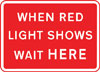 Vehicles may not pass the temporary traffic signals when the red light is shown