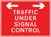 Traffic on road ahead is being controlled by portable light signals