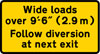 Instructions to drivers of wide loads to follow a diversion to avoid the road works ahead