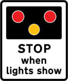Warning of light signals at a level crossing without a gate or barrier ahead