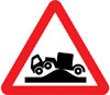Risk of grounding at a railway or tramway level crossing or hump backed bridge