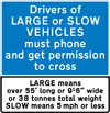 Drivers of large or slow vehicles must stop and telephone before using an automatic railway or tramway crossing