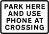 Place where drivers of large or slow, or long low vehicles should park near a level crossing while contacting the signal operator