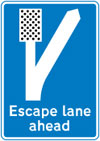 Escape lane ahead for vehicles unable to stop on a steep hill
