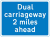 Distance of 2 miles to a section of dual carriageway ahead