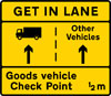 Goods vehicles should get into the left lane to attend a goods vehicle check point ahead