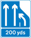 In 200 yards the number of lanes of traffic lanes ahead on a motorway reduces from three lanes to two. Traffic in the right hand lane must move into the lane on the immediate left