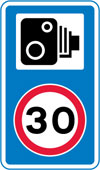 Speed camera ahead and reminder of 30 miles per hour speed limit