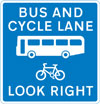 Contra-flow bus lane which pedal cycles may also use with traffic approaching from the right (reminder for pedestrians)