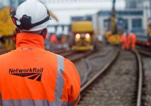 Network Raill worker on tracks Cardiff