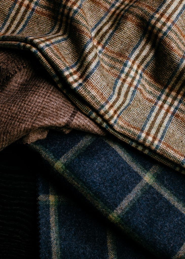 Using the beauty of woollen yarn and a double mill finish, John Foster have created an extension to their Oxbridge Flannel family in relaxed modern jacketing and suiting fabrics. Contemporary windowpanes, traditional gun club and shepherd check designs interspersed with semi-plains in complementary and classic tones