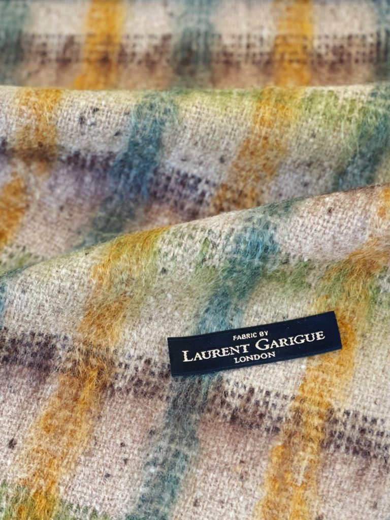 Laurent Garigue : Mohair over-checked tweed. Composition: 85% Wool 12% Mohair 3% Nylon