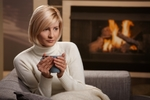 Woman keeping warm in winter