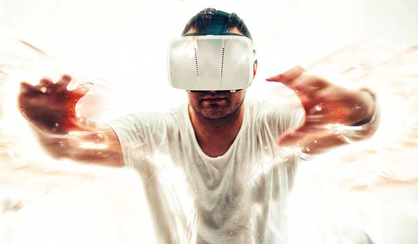 Man in VR headset all in white