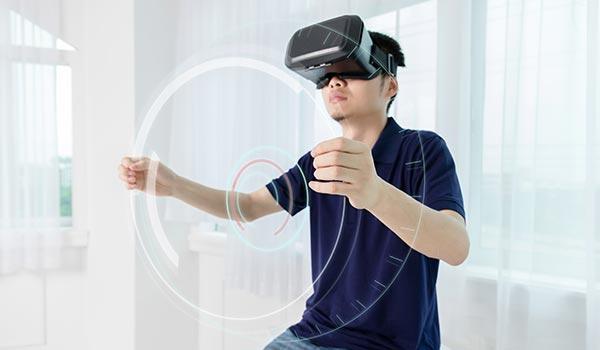 VR man holding virtual wheel