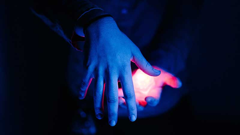 Blue hands glowing