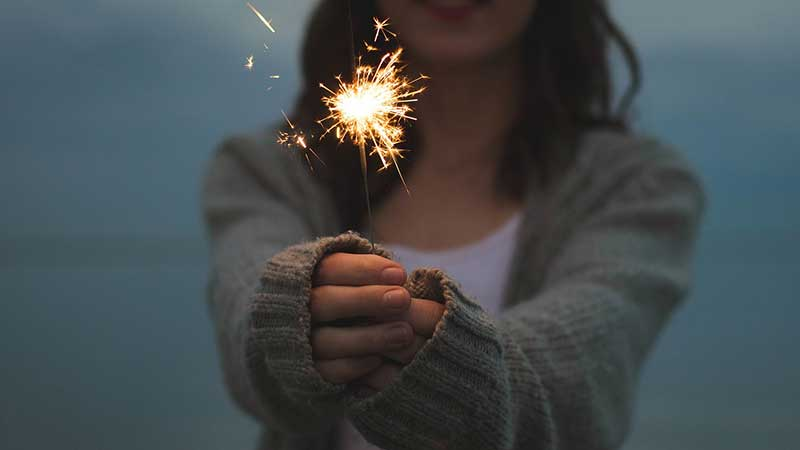 lady holding sparkler
