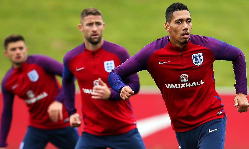 England's Chris Smalling, right, has yet to start a league game this season, unlike his fellow defenders Gary Cahill and Aaron Cresswell.