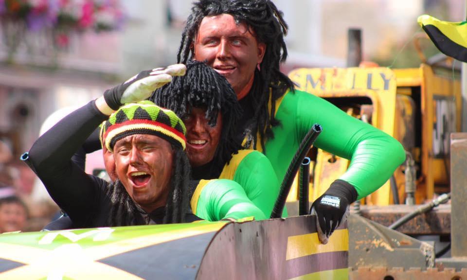 Three men ride through Aberaeron dressed as members of the Jamaican bobsleigh team in the film Cool Runnings.