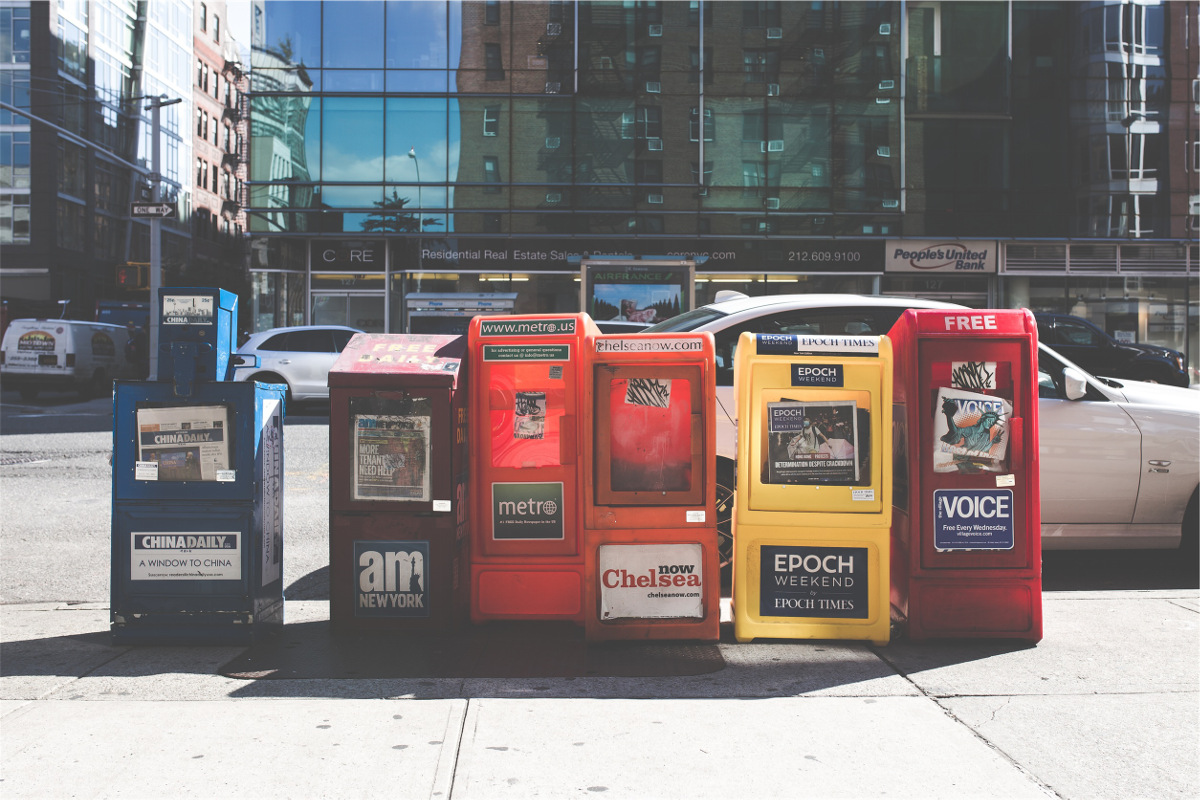 photograph picture of newspaper boxes on a street