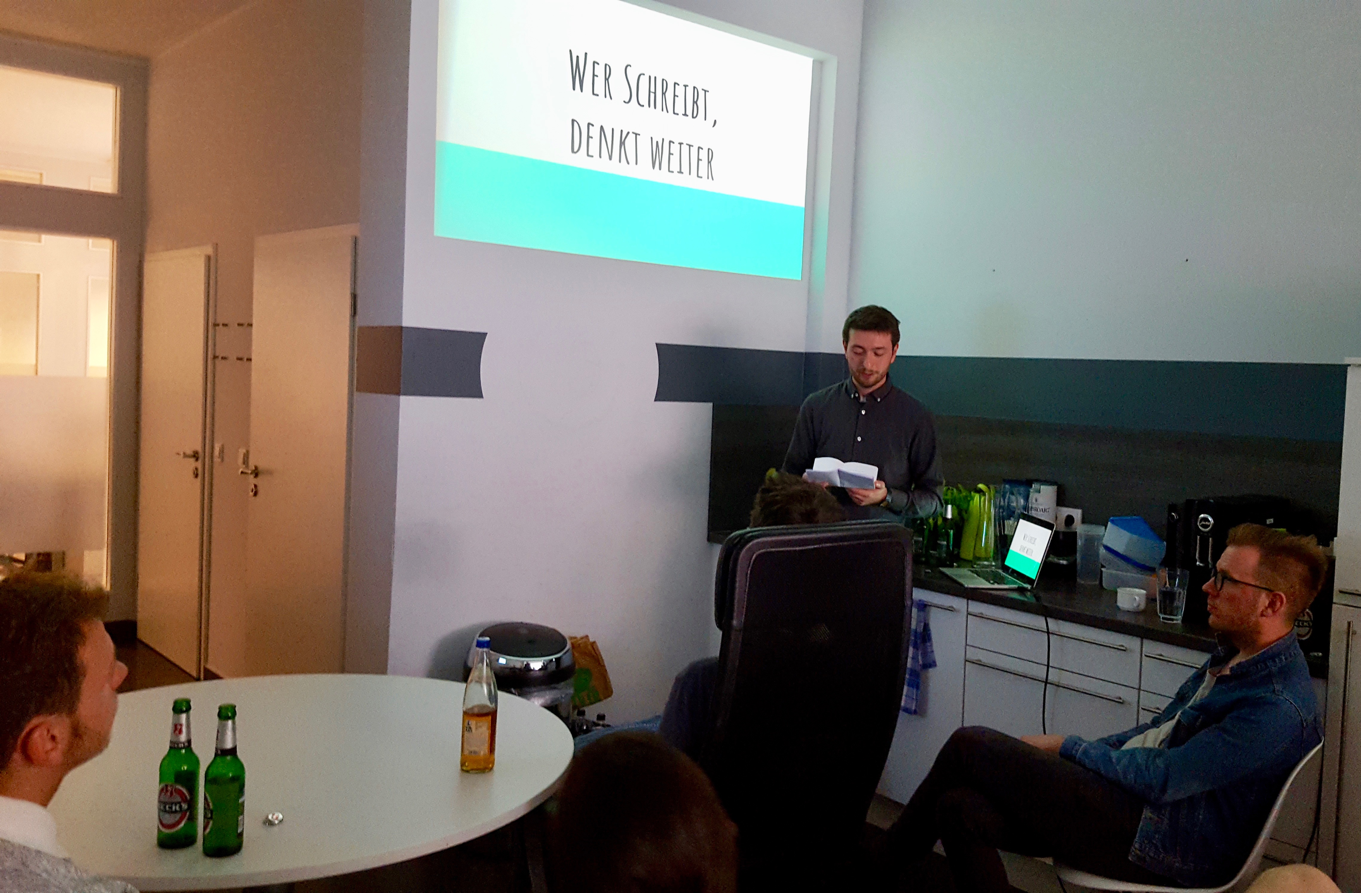 Photo of presentation on the benefits of writing at a Userlike Team event