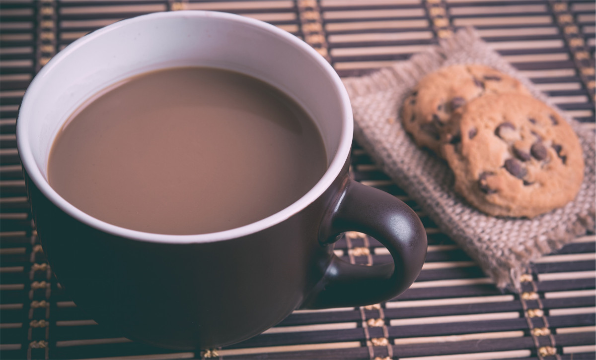 photograph picture of coffee and cookies on a table