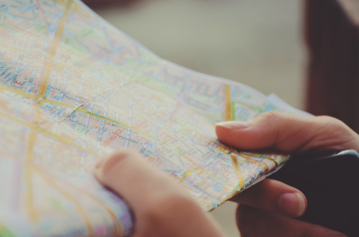 photograph picture of a map in the hands of a person