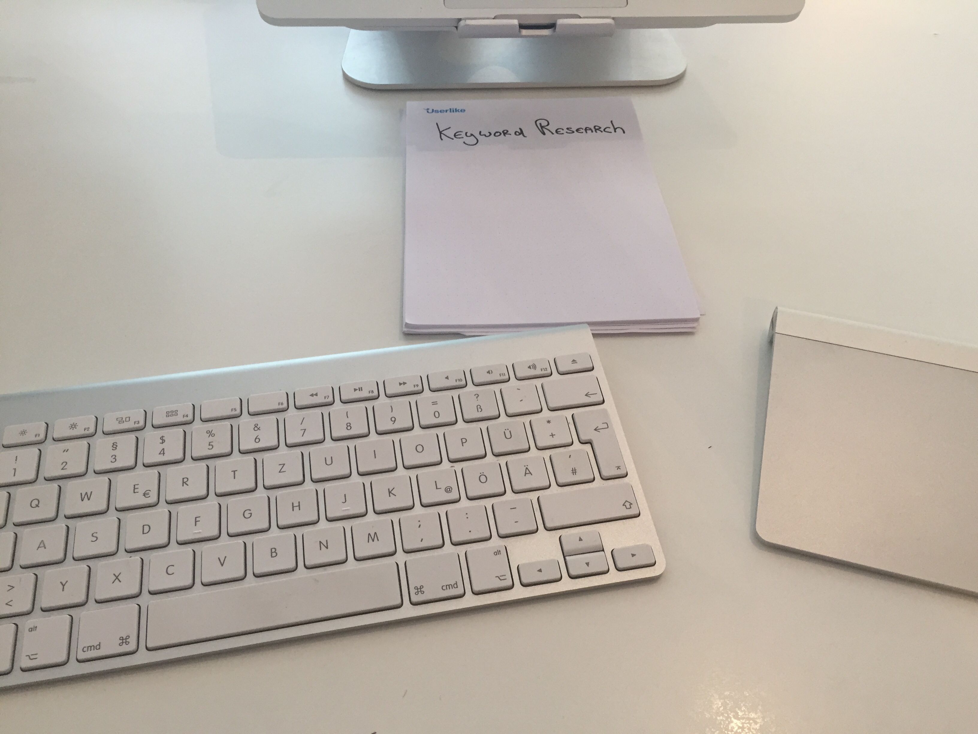 A simple notebook next to keyboard.
