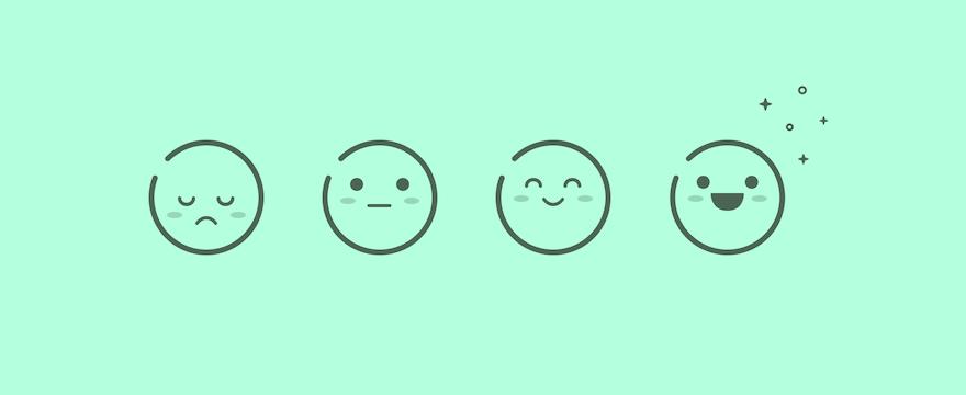 Drie emojis die klanttevredenheid verbeelden.