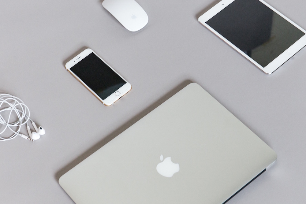 picture of desk with various Apple products