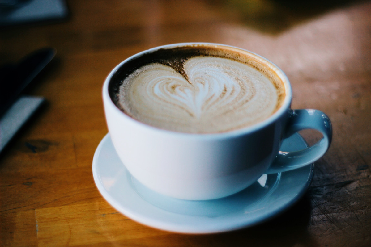 photograph picture of coffee cup with heart of foam