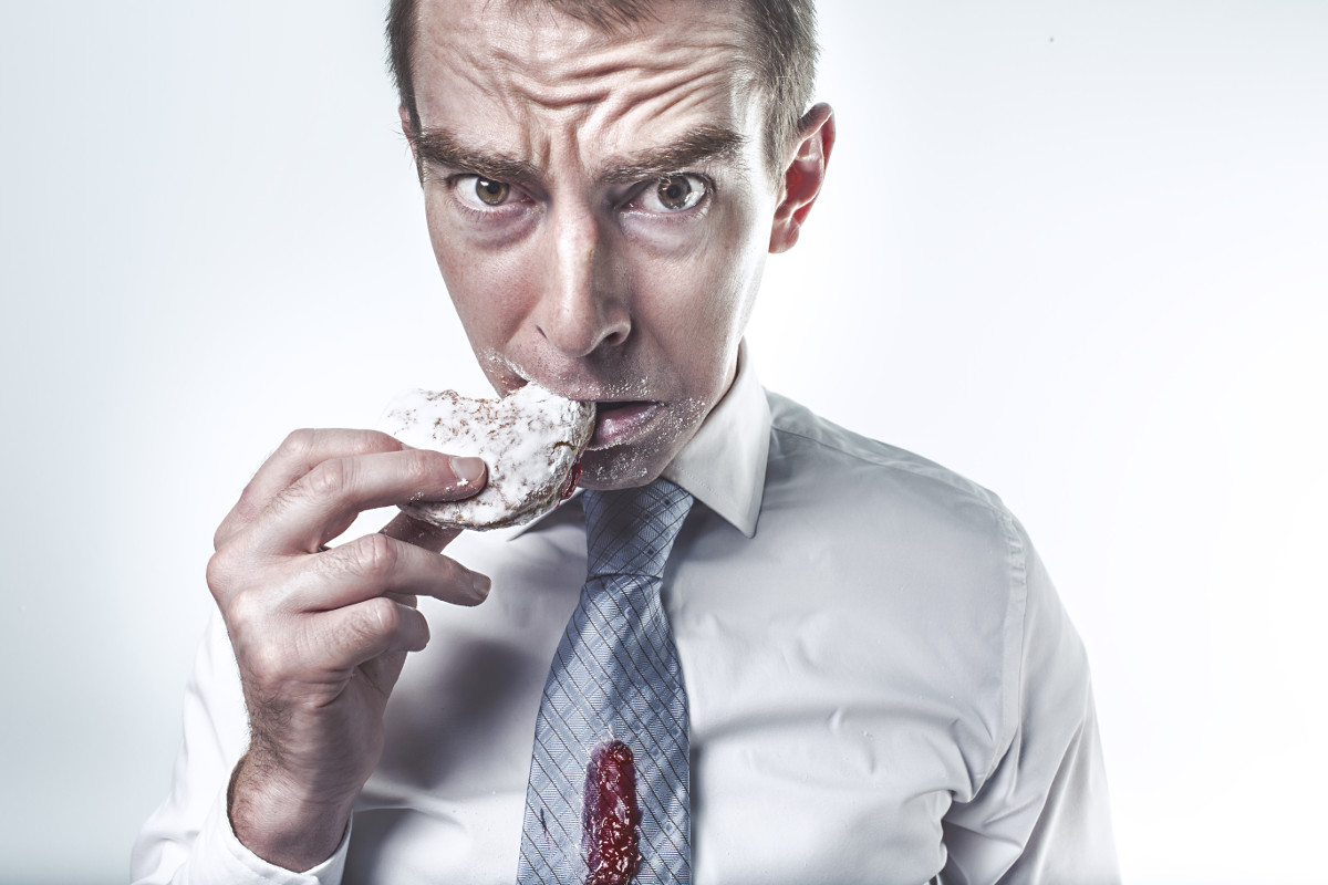 photograph picture of a manager eating a cookie