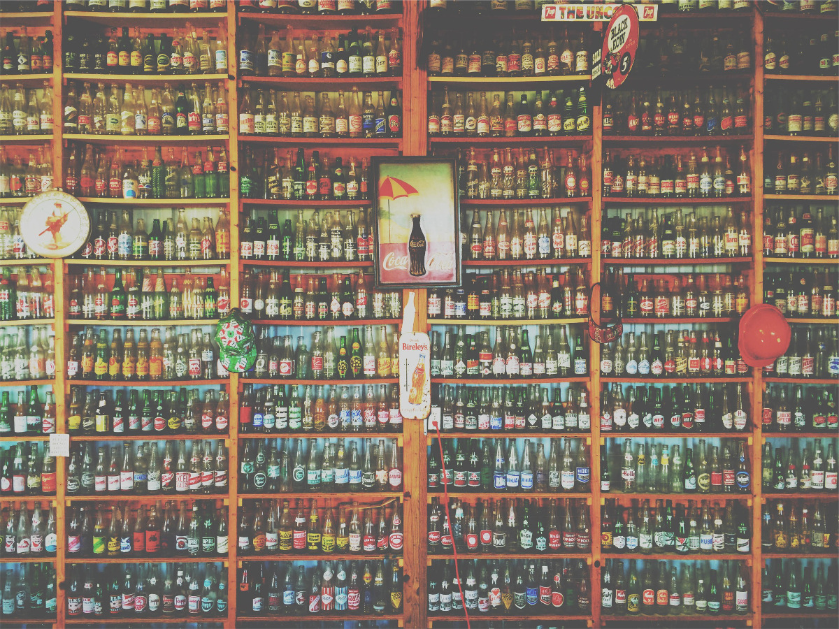 photograph picture of a goods shelf filled with bottled drinks