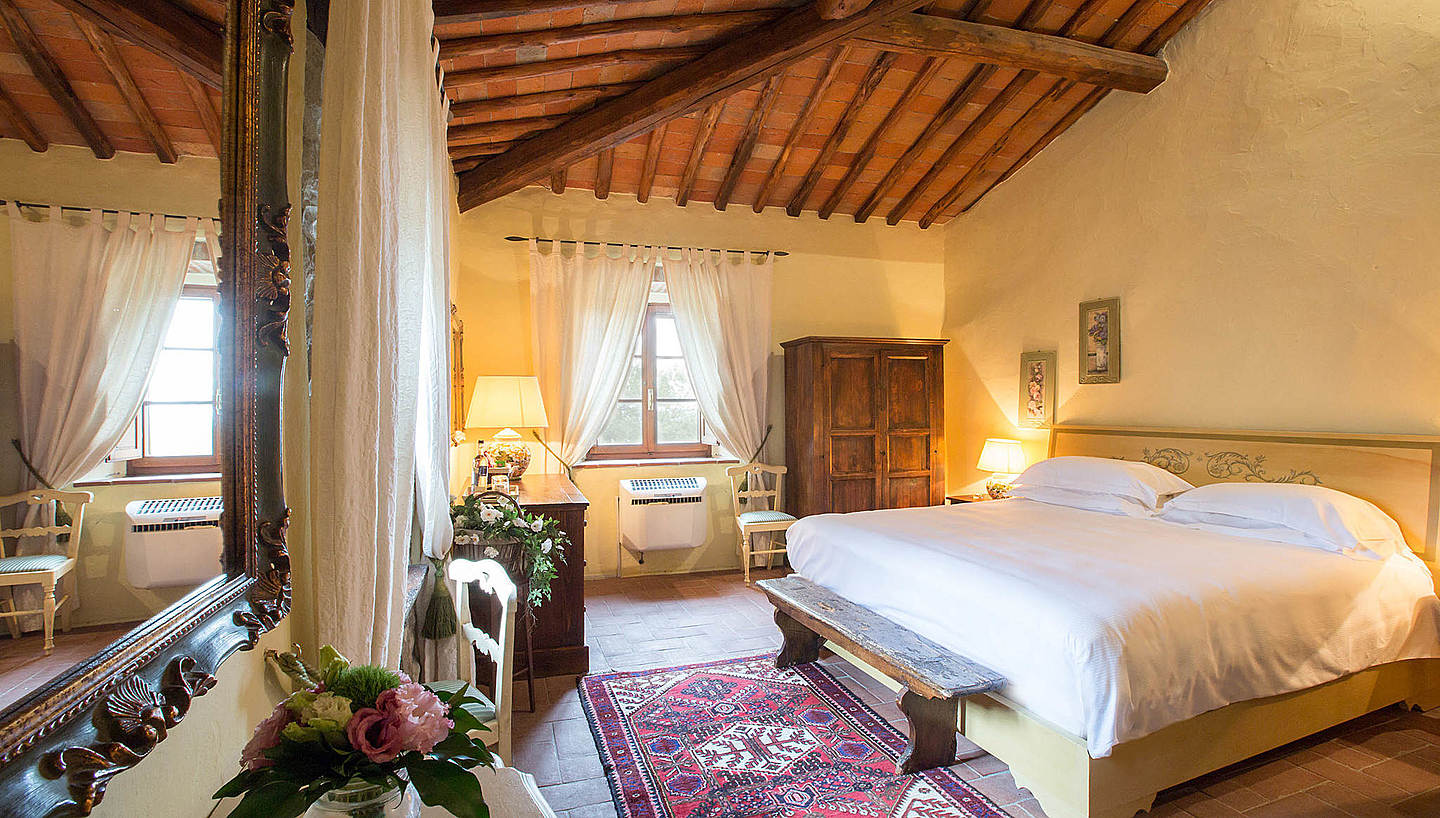 Livernano rooms are larger (30-35 sq.m.) matching the sense of space as their breathtaking views on the vineyards and surrounding forests.  Always with Tuscan furnishings.