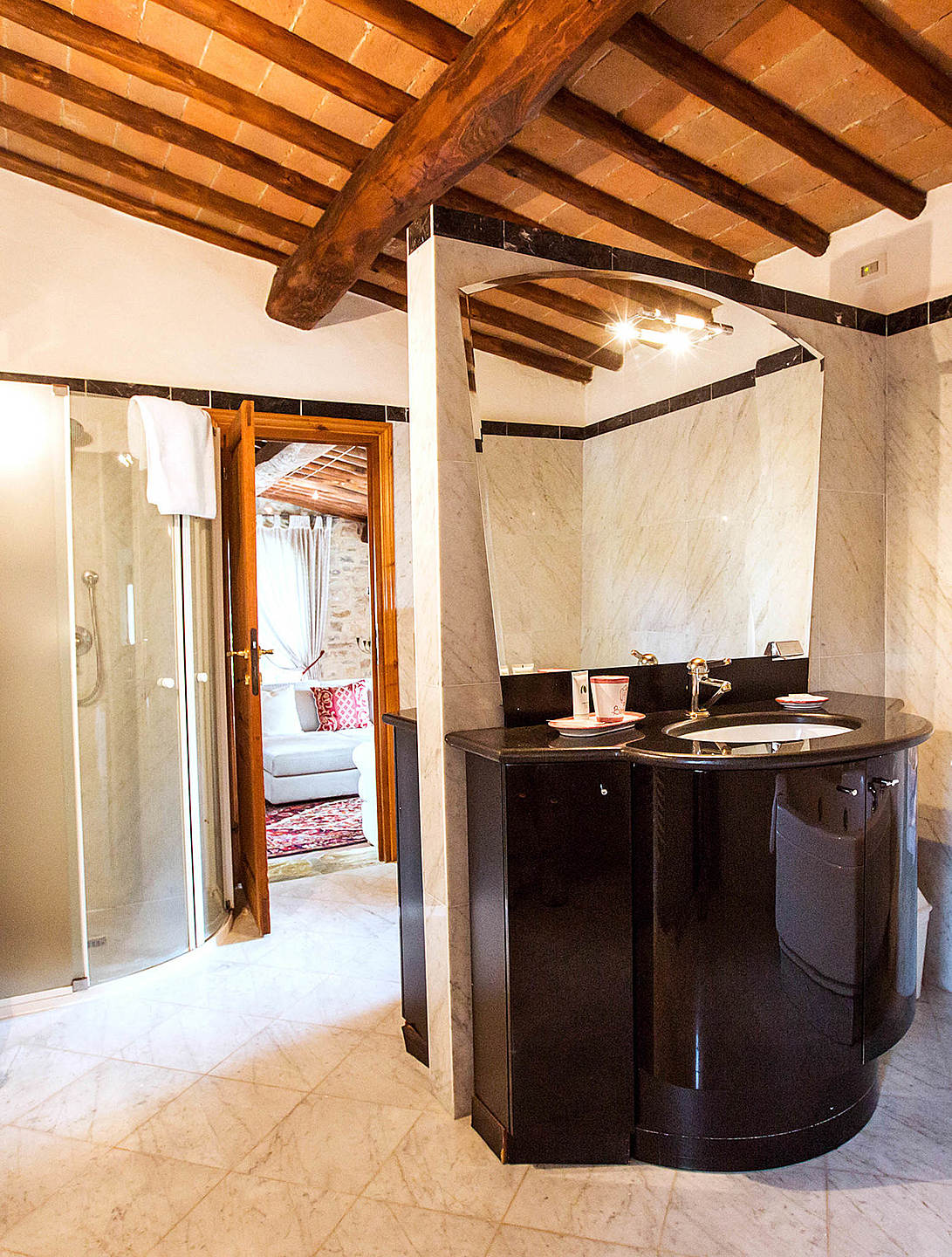 Bathrooms are brightened by Tuscany's sunshine. 