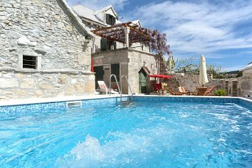 Property Donji Humac (Brač) - Accommodation 11359 - Vacation Rentals with pebble beach.