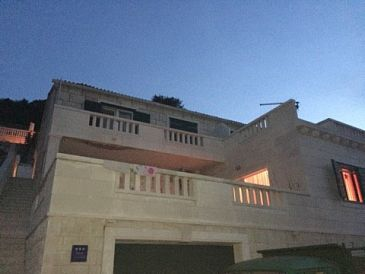 Property Pučišća (Brač) - Accommodation 11416 - Apartments with pebble beach.