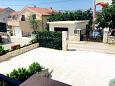 Parking lot Seget Vranjica (Trogir) - Accommodation 11734 - Apartments with pebble beach.