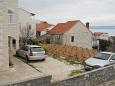 Parking lot Bol (Brač) - Accommodation 2890 - Apartments with pebble beach.