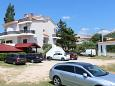 Parking lot Stara Novalja (Pag) - Accommodation 4071 - Apartments near sea with pebble beach.