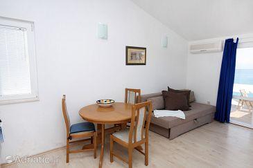 Rogoznica, Dining room u smještaju tipa studio-apartment, dostupna klima i WIFI.