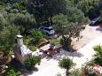 Courtyard Kozarica (Mljet) - Accommodation 4950 - Apartments near sea with rocky beach.