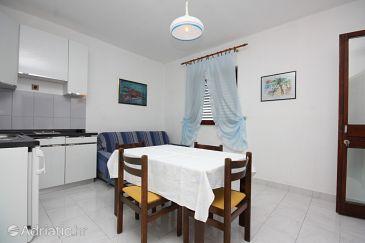 Murter, Dining room u smještaju tipa apartment, dostupna klima, dopusteni kucni ljubimci i WIFI.
