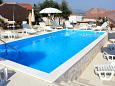 Courtyard Posedarje (Novigrad) - Accommodation 6162 - Apartments near sea with pebble beach.