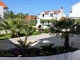 Vodice, Vodice, Courtyard 6178 - Apartments with pebble beach.
